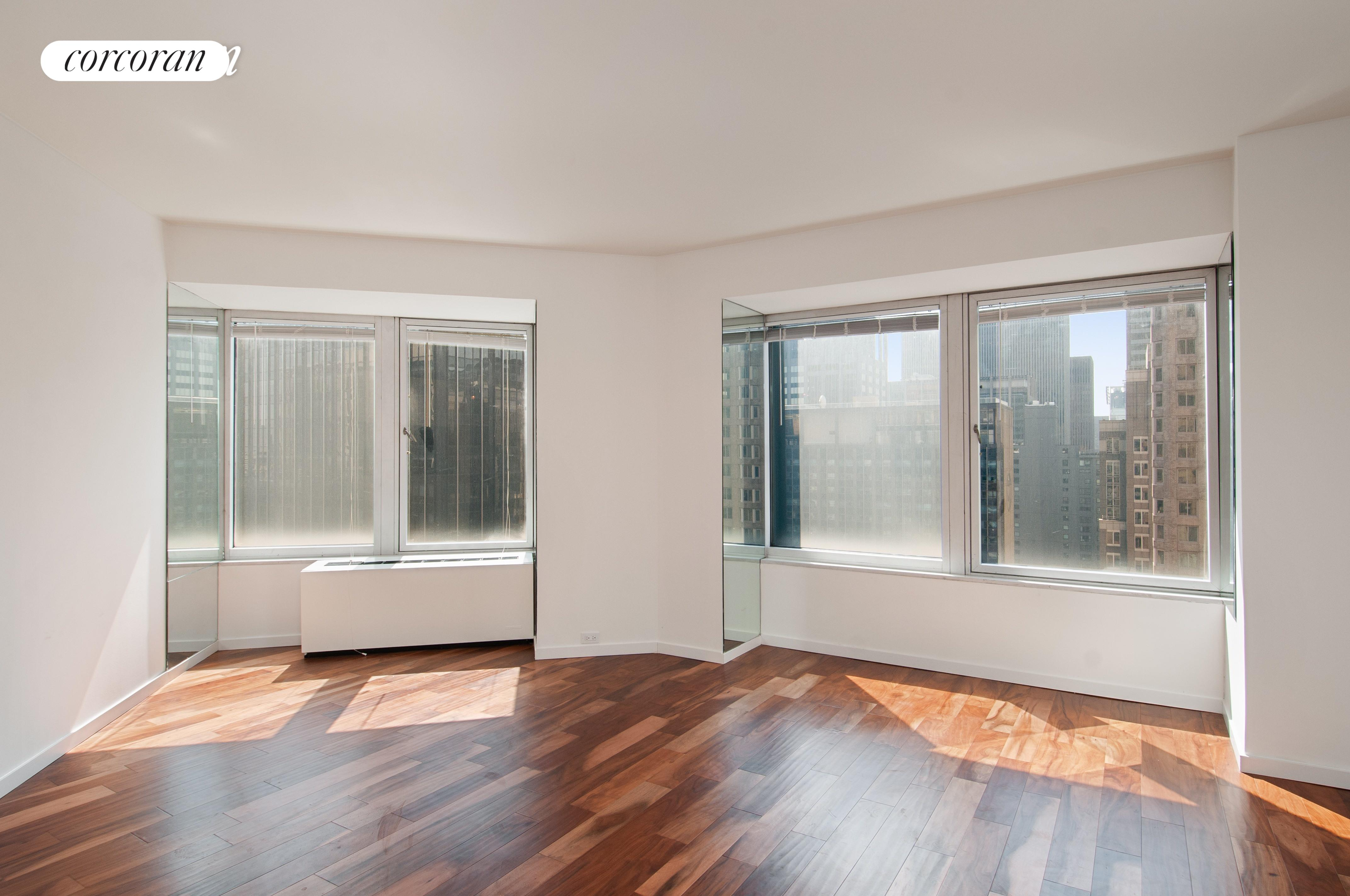 No Fee from Renter.  Large one bedroom with one and half bathrooms just came on the market. Located In heart of Manhattan, South of Central Park , the Cityspire is a White Glove Luxury condominium with 24 hour doorman /concierge. gym, swimming pool, meeting room and garage. This unit has a brand new hard-wood floor, new appliances, open city and partial river views and generous closet space. Landry room on each floor. Fine Dinning, Shopping and public transportation are all near by. Corporations, diplomats and pied-à-terre are welcome. Sorry no pets. Be the first one to see..