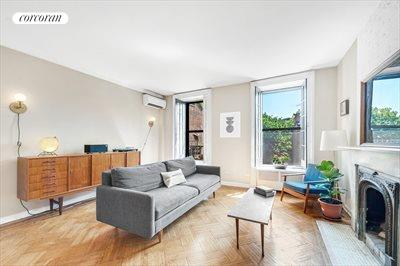 New York City Real Estate | View 30 Remsen Street, #3b | Open south facing living room with WBFP