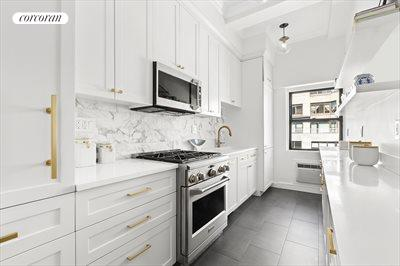 New York City Real Estate | View 1349 Lexington Avenue, #9C | Beautifully renovated custom white galley kitchen