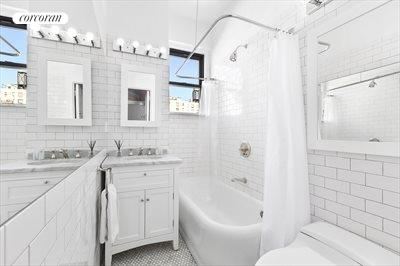 New York City Real Estate | View 1349 Lexington Avenue, #9C | Updated white tiled bathroom with tub