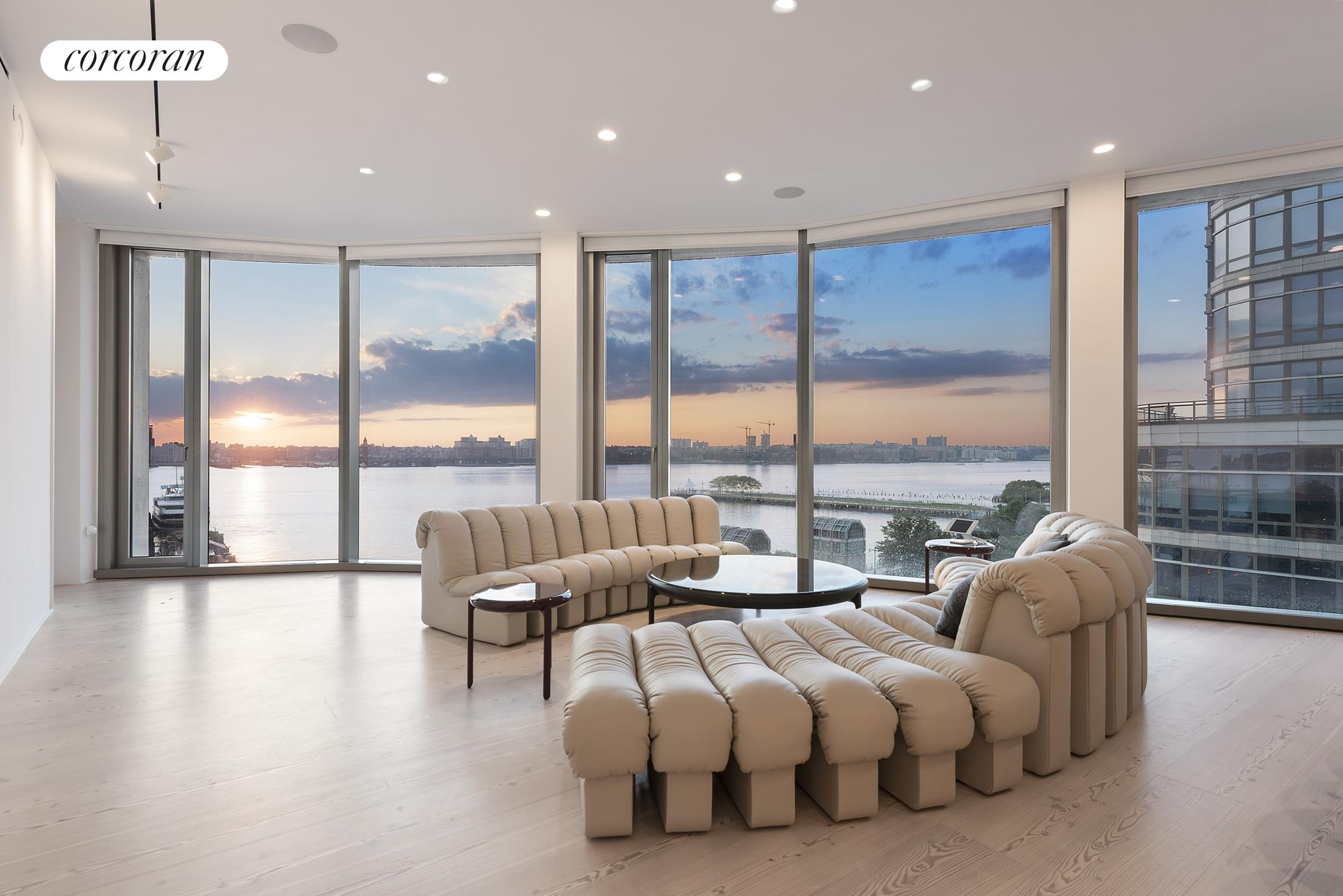 A sprawling high-floor 2792sqft 4-bedroom residence with glittering, unobstructed Hudson River views is available at 160 Leroy, the West Village's most successful new development condominium. Designed by Pritzker Prize-winning architects Herzog and de Meuron for contemporary living, this North & West sunset-facing masterpiece is situated in the desirable north tower of the condominium. Enjoy sweeping river views from every major room through 11' floor-to-ceiling windows, and an open crescent-shaped floorplan with ample large wall spaces for your art collection. From a semi-private hallway, enter an elegant gallery leading to dramatic corner Great Room with direct sunset water views.  An open Bulthaup kitchen with Scandinavian Larch wood cabinets and creamy Sivec marble slab countertops and backsplash and a unique enclosed Chef's kitchen offers opportunities for formal and relaxing entertaining options.The highest-end kitchen appliances include a Sub-Zero refrigerator, Wolf convection & steam oven, Gaggenau cooktop,  Miele dishwasher,  wine refrigerator, and built-in Miele coffee/espresso machine. Winged separately from the secondary bedrooms is a stunning Master bedroom suite with serene Hudson River views, a Transform-customized dressing room, and a lavish Hudson waterfront 5-fixture master bath with a deep Kaldewei soaking tub, radiant heated floors, dual Sivec marble vanity, oversized stall shower, and water closet. The additional 3 bedrooms have en-suite bathrooms with large custom vanities and Corian sinks. The 4th bedroom-adjacent to the the Great Room-can also function as a study or media room with open river views.  A jewel-like powder room has floor-to-ceiling Scandinavian larch wood, copper fixtures and has a floating Sivec marble vanity. This home also features a laundry area with a sink and vented washer/dryer. Custom details include: smartly pre-wired for AV; Lucifer lighting, acoustic fabric wrapped ceiling, hidden surround sound Sonance speaker system