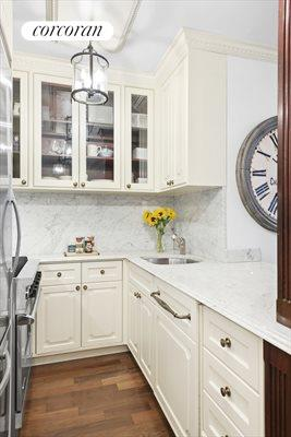 New York City Real Estate | View 30 East 62nd Street, #2H | Functional kitchen with high end appliances