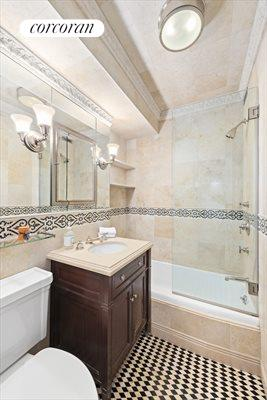 New York City Real Estate | View 30 East 62nd Street, #2H | Luxurious bathroom with marble appointments