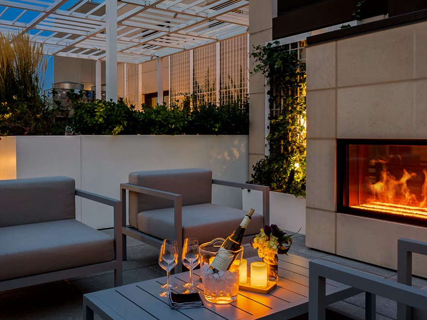 New York City Real Estate | View 1289 Lexington Avenue, #11D | Rooftop Terrace with Fireside Seating