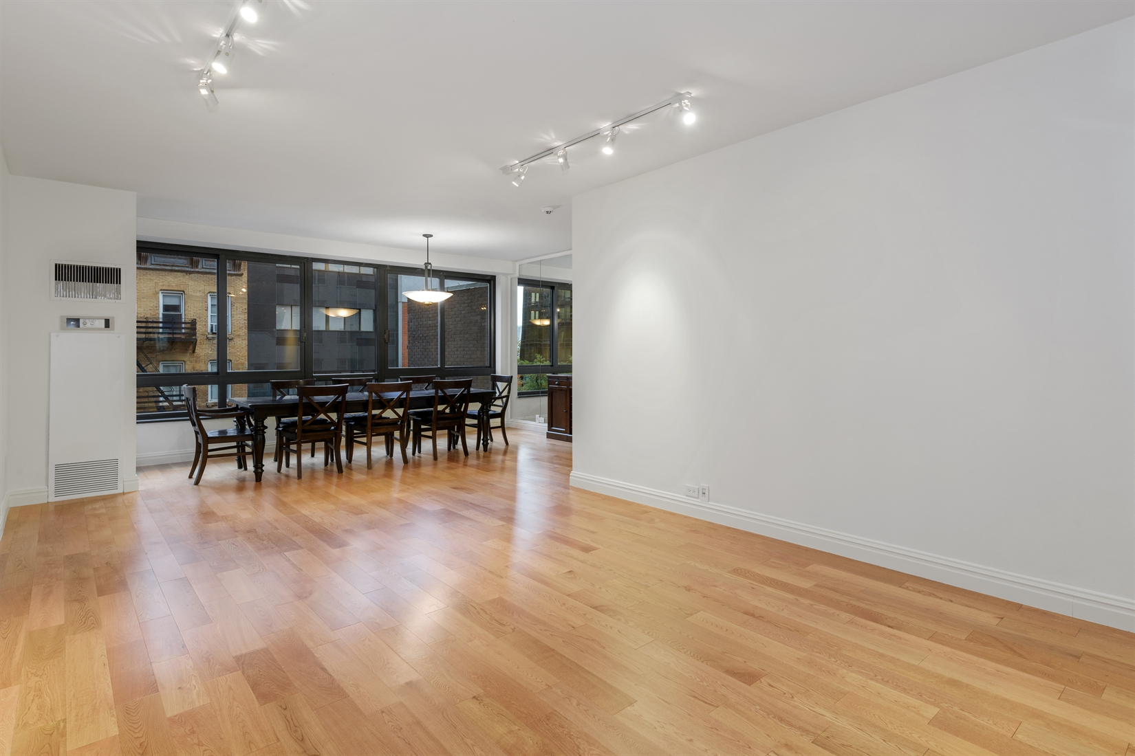 Rarely available, beautifully renovated and spacious split 2 bedroom, 2.5 bathroom apartment available for rent at 100 United Nations Plaza, a premier, white-glove condominium in Midtown East.Measuring approximately 1,321 square feet, unit 5E features a large living room and dining alcove, fully renovated kitchen and two bedrooms, each with its own en suite bathroom. The living and dining room will effortlessly accommodate multiple seating arrangements and dining for at least 8 guests. This flexible layout is ideal for day-to-day living and large enough for hosting small gatherings at home. The renovated kitchen has been completely upgraded and boasts granite counters and backsplash, a 6-burner Bertazonni range, French door refrigerator by Viking, Bosch dishwasher and undermount microwave. There is ample storage space and a double bowl stainless steel sink.The north-facing primary bedroom suite is pin-drop quiet and has an en suite marble bathroom with whirlpool bathtub and an extra-wide vanity. There is also a fully custom-outfitted walk-in closet. Equally as spacious is the south-facing second bedroom with a large floor-to-ceiling closet and an en suite marble bathroom with soaking bathtub. This move-in ready apartment has beautiful wood flooring, oversized windows, central heat and A/C, and a guest powder room.Located on East 48th Street and First Avenue, 100 United Nations Plaza is a white-glove, full service condominium in Manhattan's Turtle Bay neighborhood. Greeting residents with beautifully landscaped gardens and waterfalls, this impeccably run building offers a 24-hour doorman, valet and concierge service, on-site management office, renovated lobby and resident's lounge, common laundry room, fitness center and direct access to a 24-hour attended parking garage. Conveniently located to transportation and many great shops and restaurants. Condominium application required. Sorry, no pets.Showing by appointment only.
