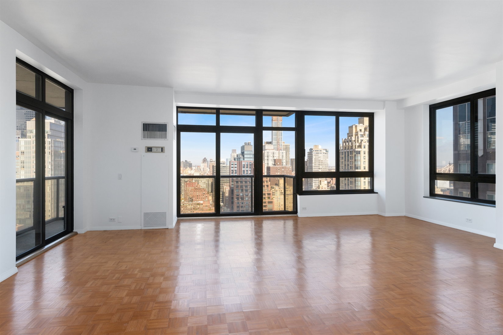 Largest 1 bedroom, 1.5 bathroom layout high on the 32nd floor boasting spectacular city views now available for rent at 100 United Nations Plaza, one of Midtown East's premier white-glove condominiums.Stepping in to this north-facing apartment measuring approximately 1,242 square feet you will be immediately drawn to the generous open living and dining room showcasing idyllic skyline views from its floor-to-ceiling windows with north, west and east exposures. An ideal space for entertaining with the adjacent galley kitchen, you and your guests can also take in the sights from the 105 square foot (approximately) wrap-around balcony. The galley kitchen has a Brand New Liebherr refrigerator, full-size dishwasher, gas range and large pantry closet. Down the hallway you will find the incredibly spacious north-facing bedroom suite boasting an en suite windowed 5-piece marble bathroom, separate dressing area with an additional vanity and sink, a walk-in closet plus 4 substantial floor-to-ceiling closets.Additional features of this incredible apartment include 9 foot ceilings, central heat and A/C as well as a windowed marble powder room.Located on East 48th Street and First Avenue, 100 United Nations Plaza is a white-glove, full service condominium in Manhattan's Turtle Bay neighborhood. Greeting residents with beautifully landscaped gardens and waterfalls, this impeccably run building offers a 24-hour doorman, concierge and valet, on-site management office, renovated lobby and residents' lounge, common laundry room, fitness center and direct access to an attended parking garage. Conveniently located to transportation and many great shops and restaurants.