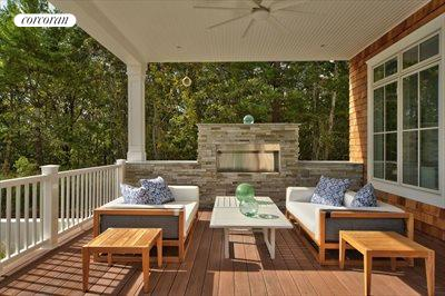 The Hamptons Real Estate | View 12 Water Mill Heights Drive | covered porch with fireplace