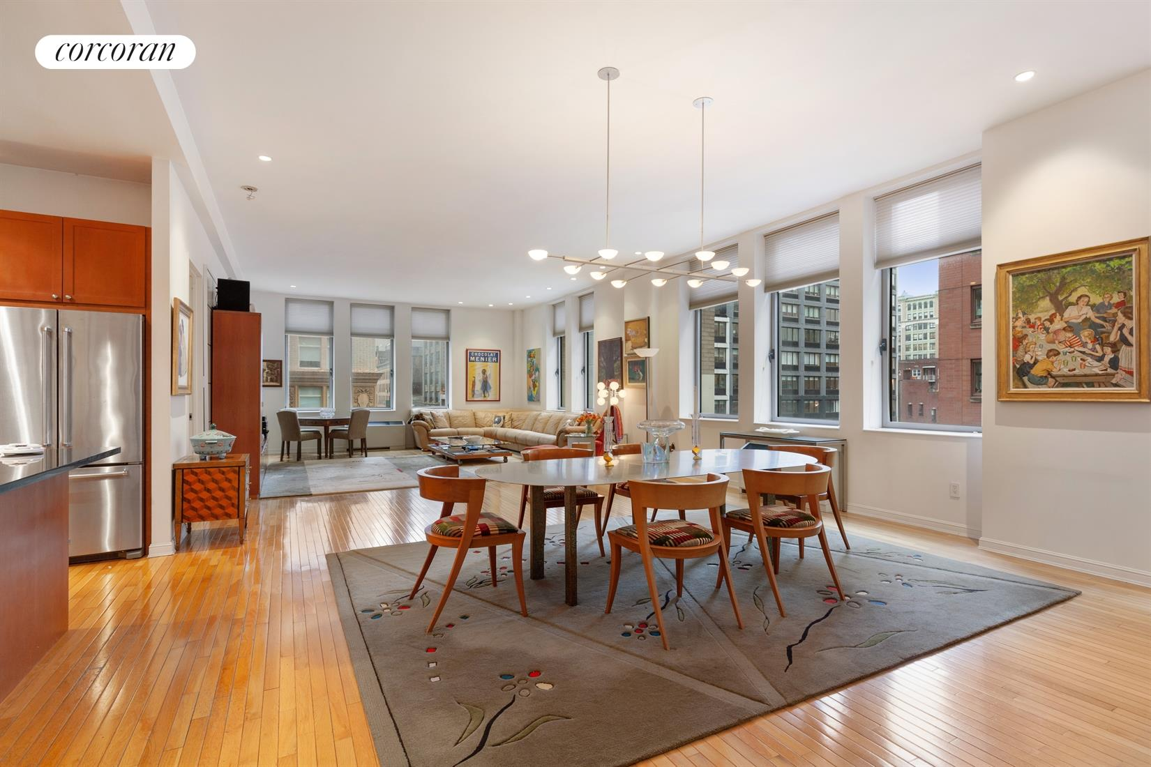 "This Chelsea Mercantile loft occupies the most coveted corner of the building. The living/dining room measures  approximately 44' long by 20' wide, features 9 enormous windows and, the soaring ceiling height of 10'6"" give it a truly grand scale. There are 2 over-sized bedrooms with ensuite baths and an additional guest bath (3 full baths in total).The entire apartment is sun drenched with light from the south and east. A well configured open kitchen includes stone counters and wood cabinetry. A washer/dryer can easily be added to the existing hookups. And, a storage cage is included. Building amenities include a 24 hour doorman and concierge, conference/meeting room, clothing valet, a stunning roof deck, a state of the art gym, and playroom. Whole Foods is just an elevator ride away. There is also a 24 hour parking garage with direct access. Additional assessment for façade repair $475 ending 2/2022"