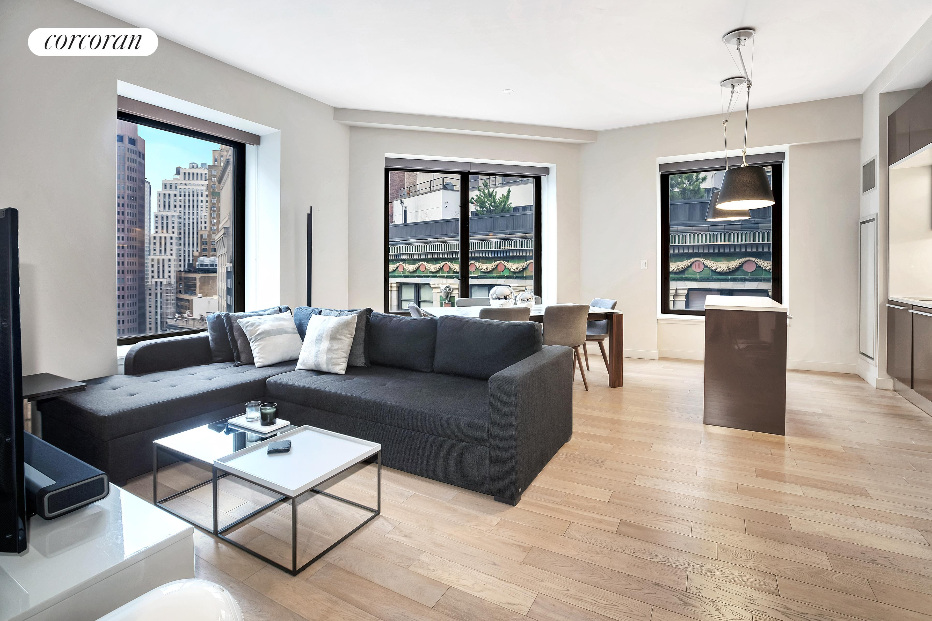 "Welcome home to this sprawling 1,367 SF corner, 2 Bedroom + Home Office, 2.5 Bathroom apartment featuring oversized windows with southwest exposures, offering exceptional natural light and showcasing breathtaking views of the East River, Brooklyn skyline and Lower Manhattan.This highly coveted, F-line offers a generously proportioned, layout featuring a 21ft by 21ft living and dining room, lofty 10 foot ceilings and wide-planked cerused oak flooring throughout. This Rockwell designed residence features an open BOFFI chef's kitchen with a center island, Caesarstone Countertops, lacquer kitchen cabinetry and to top-of-the-line appliances including Subzero refrigerator, Bosch oven and range, Miele dishwasher and Sharp microwave. Additional features include an individual heat pump HVAC system with Nest Thermostat, in-home Bosch washer/dryer, designer light fixtures and custom roller shades and blinds  throughout.Enjoy East River & Hudson River views from the oversized master suite which features two closets and a crisply-lit 5-piece en suite bathroom clad in custom wood cabinetry and Botticino Semi Classico Marble Floors. The second bedroom features spectacular views and a generous walk-in closet. The bonus home office can be customized to meet your ""work from home needs"" or could be utilized for extra closet and storage space.The building features just over 30,000 SF of amenities including; access to all Andaz services, a residents lounge with billiards and private screening room, a state-of-the-art fitness center with yoga & ballet studio, and a rooftop terrace spanning the entirety of the building with bar, lounge and indoor/outdoor fireplace. With easy access to nearly every subway line and the newly constructed Fulton Center, to major food markets and restaurants like Eataly, Nobu, El Vez, Blue Smoke, North End Grill, and many more, there's something for everyone. Enjoy shopping at Brookfield Place buzzing with prominent brands such as Le District, Saks Fifth Avenue, Hermes, and Burberry. There's also the South Street Seaport a short distance away with its many shops and eateries situated on the East River with stunning views of Brooklyn and Manhattan's historic bridges."