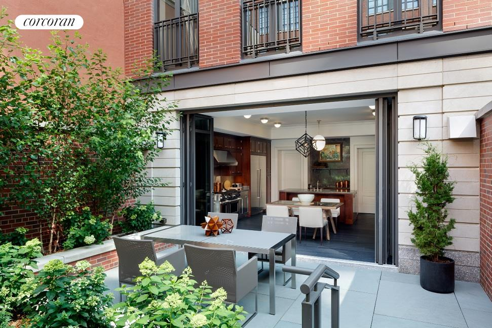 """The final Townhouse at The Greenwich Lane! Enjoy townhouse living with the conveniences and amenities of a full-service condominium.    133 West 11th Street is a 6,574 sq. ft. newly constructed 22'4"""" wide townhouse with six levels and over 1,600 sq. ft. of private outdoor space. Features of this single family home include a private elevator, 4 bedrooms with en-suite baths, 4 powder rooms, and   2 fireplaces. The Townhouse is uniquely set apart with 24-hour concierge, package delivery, and maintenance services, direct access to the private valet parking garage and exclusive membership to The Greenwich Lane's state-of-the-art fitness center that includes   a 25 meter swimming pool, whirl pool, steam rooms, golf simulator, and treatment room all managed by La Palestra. This Townhouse also enjoys the central garden and reflecting pool, residents' lounge, dining room with chef's kitchen, a luxurious 21-seat screening   room, playroom, and bicycle and cold storage.    A beautifully landscaped front garden and gate provide a distinguished entrance to 133 West 11th Street. Past the painted steel entry door is a foyer with marble mosaic flooring, powder room, a south-facing library, and a formal entrance gallery featuring a   handcrafted, sky-lit, oval staircase. The spacious eat-in chef's kitchen is equipped with Wolfe, Miele, and Sub-Zero appliances and opens onto a private garden patio through a state-of-the-art floor-to-ceiling glass NanaWall. The second level is a classic   parlor floor with formal dining room and expansive living room with gas burning fireplace with marble surround. The luxurious master suite, occupying the entire third floor, includes a fireplace, banks of generous closets, a private dressing room, and a windowed,   marble-clad master bath. The fourth level has three secondary bedrooms with en-suite baths and a home office. The fifth level features a powder room, and expansive north and south facing private terrace with gas grill. Additional features """