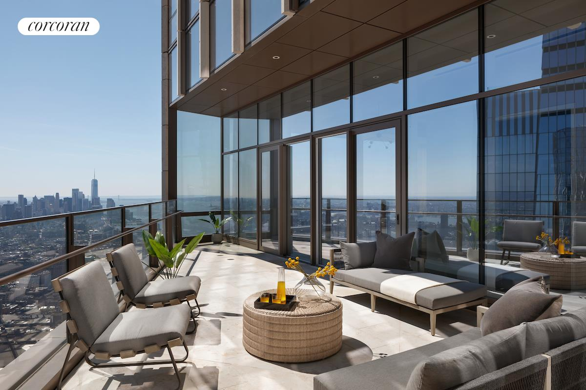 """GRAND FULL-FLOOR FIVE-BEDROOM PENTHOUSE WITH 360 DEGREE RIVER AND CITY VIEWS WITH PRIVATE TERRACE.Enter this remarkable 10,171 square foot """"compound in the sky"""" that encompasses the entire 90th floor by private elevator landing. No detail was overlooked in this expertly planned residence boasts ceiling heights up to 14 feet and lavishly finished, 7.5-inch-wide, French oak floors. The expansive Great Room spans over 1000 square feet, showcasing limitless southern views extending for miles towards downtown Manhattan, the Freedom Tower, the Statue of Liberty, East River Bridges, and even the Atlantic Ocean, flanked by two inviting fireplaces and extensive art walls for showcasing your collection. The dining room easily seats 12, and opens directly onto one of the city's most magical private terraces, 454-square-foot with room for alfresco dining and lounge furniture with views that span from the Atlantic Ocean to Central Park on the horizon. Outfitted with luxurious Smallbone of Devizes cabinetry, the oversized corner kitchen with large, inviting breakfast room and bar seating is at once separate but remains the heart of the home. Opal White Marble island, counters and backsplash, a full suite of Gaggenau appliances, with wine refrigeration, wet bar, and service entrance complete the details Numerous additional living spaces punctuate the floor plan, including a Lounge with southwest views to enjoy sunsets over the Hudson River, a private library office, a home gym, and the most comfortable, inviting media room in the city, with views that span the entire Midtown skyline. The primary bedroom suite is perfectly positioned on the prime northwest corner to enjoy river views up to the George Washington Bridge and the unique combination of utmost privacy beautiful light and dazzling views. The oversized bedroom is en-suite with wet bar, dual dressing rooms and dual windowed bathrooms, wrapped in stunning iceberg quartzite, complete with a double vanity with Kinon panels, an"""