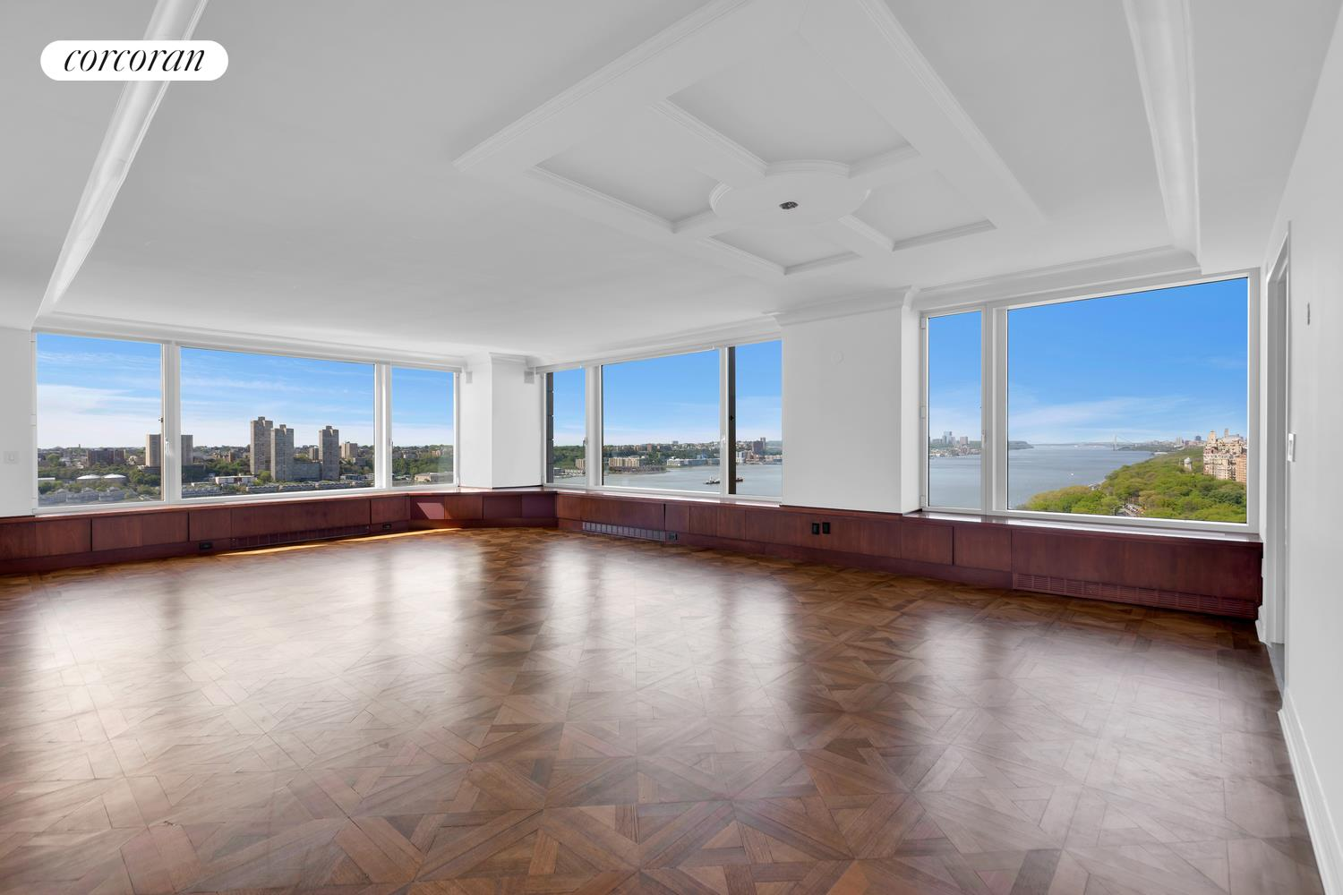 Located along Riverside Boulevard, one of Manhattan's premier residential retreats, in one of the Boulevard's full-service luxury buildings, this high-floor corner four-bedroom, four-and-a-half-bathroom condominium boasts breathtaking open views from every room! Wide open Hudson River, Riverside Park and city skyline views as far as the eye can see provides one of the most desirable vantage points in the city. An aerial view spanning the length of Riverside Park all the way to the George Washington Bridge offers a beautiful seasonal perspective. Brilliant sunsets are guaranteed every night!  The expansive 4,500 SF layout offers grand proportions and is sun-filled throughout the day with 3 open exposures from high atop the 23rd floor. This open loft-like floor plan presents a massive formal entertaining expanse with corner living room, library, eat-in kitchen and a corner formal dining room or den / media room featuring over 100 feet of stunning River and Park views.  This special home allows for flexibility and offers a private residence wing with four bedrooms each with en-suite bathrooms and very generous custom storage including multiple walk-ins. All 4 bedrooms face east boasting wide open city and skyline views and the primary corner suite also boasts River views.   The gorgeous open chef's kitchen faces the Park and the River and is as functional as it is sleek. A huge central island creates seating for casual dining and gathering. Top of the line stainless appliances include Sub Zero refrigerator, Wolf 6-burner gas range oven with Miele hood, Wolf convection wall oven, Miele dishwasher and Viking wine refrigerator. Additional luxuries include central AC and heating, laundry and a sublime master bath with double vanity, spa shower and deep-soaking tub overlooking the River! Extraordinary features come together with this fabulous Riverside home coupled with the luxury lifestyle amenities that come with owning a home at the 240 Riverside Boulevard.