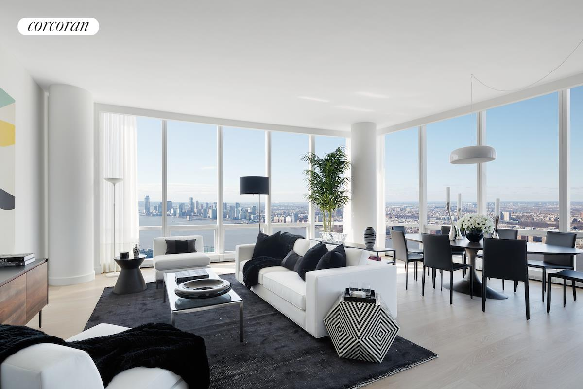 """EXPERIENCE THE MOST DRAMATIC CITY AND RIVER VIEWS FROM THIS HIGH FLOOR FOUR-BEDROOM AERIE!Located on the prized southwest corner of Fifteen Hudson Yards, this remarkable home enjoys grand proportions and mesmerizing views of the Hudson River, New York Harbor, Statue of Liberty, Freedom Tower and Downtown skyline from morning to night! The gracious 6-foot wide foyer leads to the giant great room with ceilings up to 10'10"""" and stunning views in every direction. The oversized open kitchen features a grand marble island, Bulthaup cabinetry with large pantry and Miele appliances including double ovens and wine storage. The master suite is very private, enjoying river views, an oversized bathroom with soaking tub and large shower and two massive walk-in closets. Two additional bedroom suites enjoy en-suite baths and a walk-in laundry room, while the fourth bedroom could also double as a library, office or media room and could be opened to the great room if desired.Designed by Diller Scofidio + Renfro in collaboration with Rockwell Group, Fifteen Hudson Yards offers residents over 40,000 square feet of amenities on three floors. Floor 50 has been devoted to the full range of fitness and wellness opportunities, including an aquatics center with a 75-foot long swimming pool, a 3,500 square foot fitness center designed by The Wright Fit, private studio for yoga, stretching and group fitness classes, spa with treatment rooms, and a beauty bar for hair and makeup services. Floor 51 features two corner private dinner suites including wine storage and tasting rooms, lounge with breathtaking Hudson River views, club room with billiards tables, card tables and large-screen TV, a screening room, business center, golf club lounge, and an atelier with communal working table and lounge seating. Occupying a prime position on the Public Square and Gardens at the center of Hudson Yards, 15 Hudson Yards is directly on the High Line and adjacent to The Shed, New York's first arts center to """