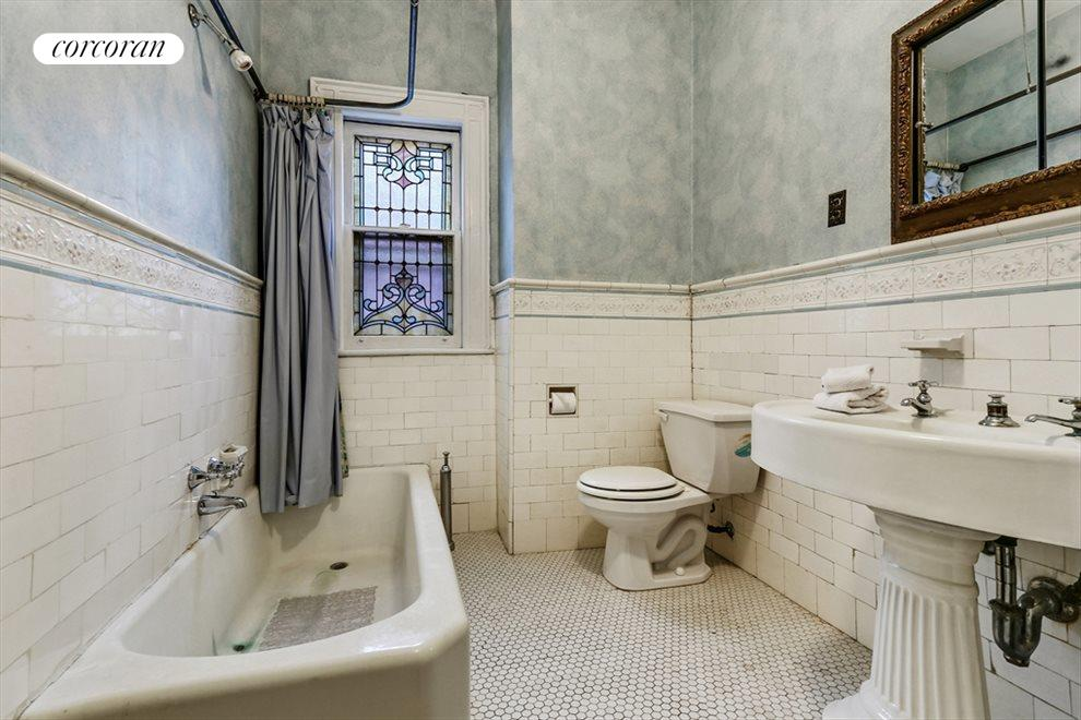 New York City Real Estate | View 633 East 19th Street | Original tiles and stained glass window