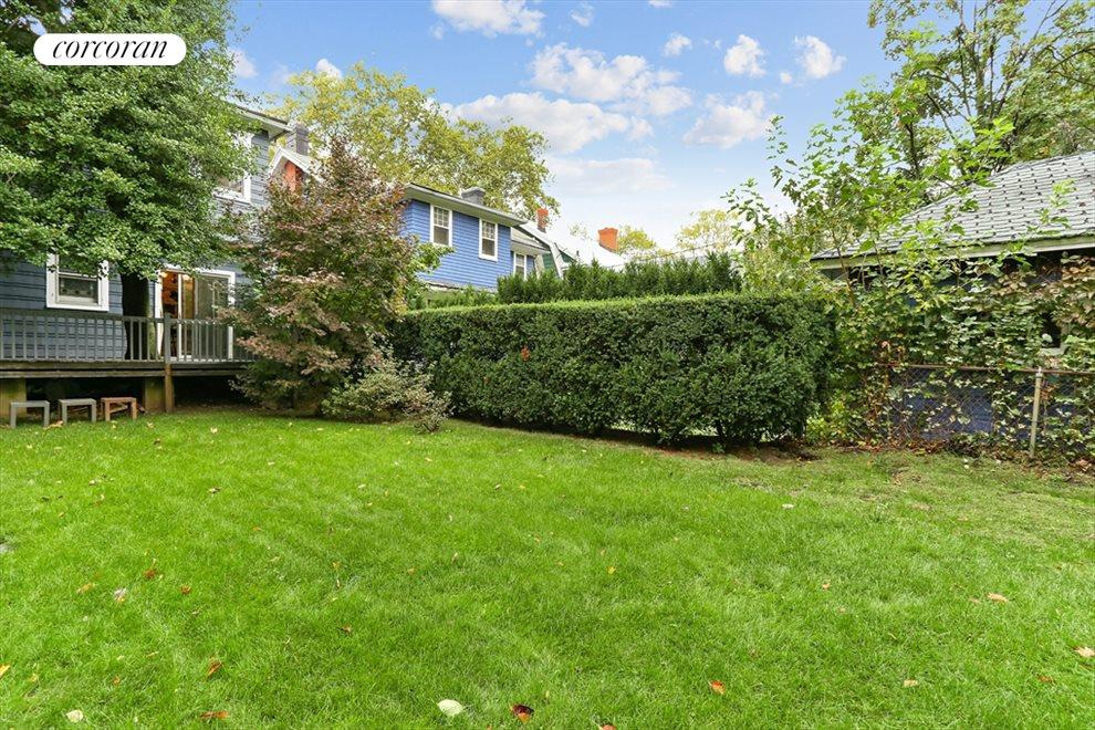 New York City Real Estate | View 633 East 19th Street | Deep and wide back yard + 2 car garage