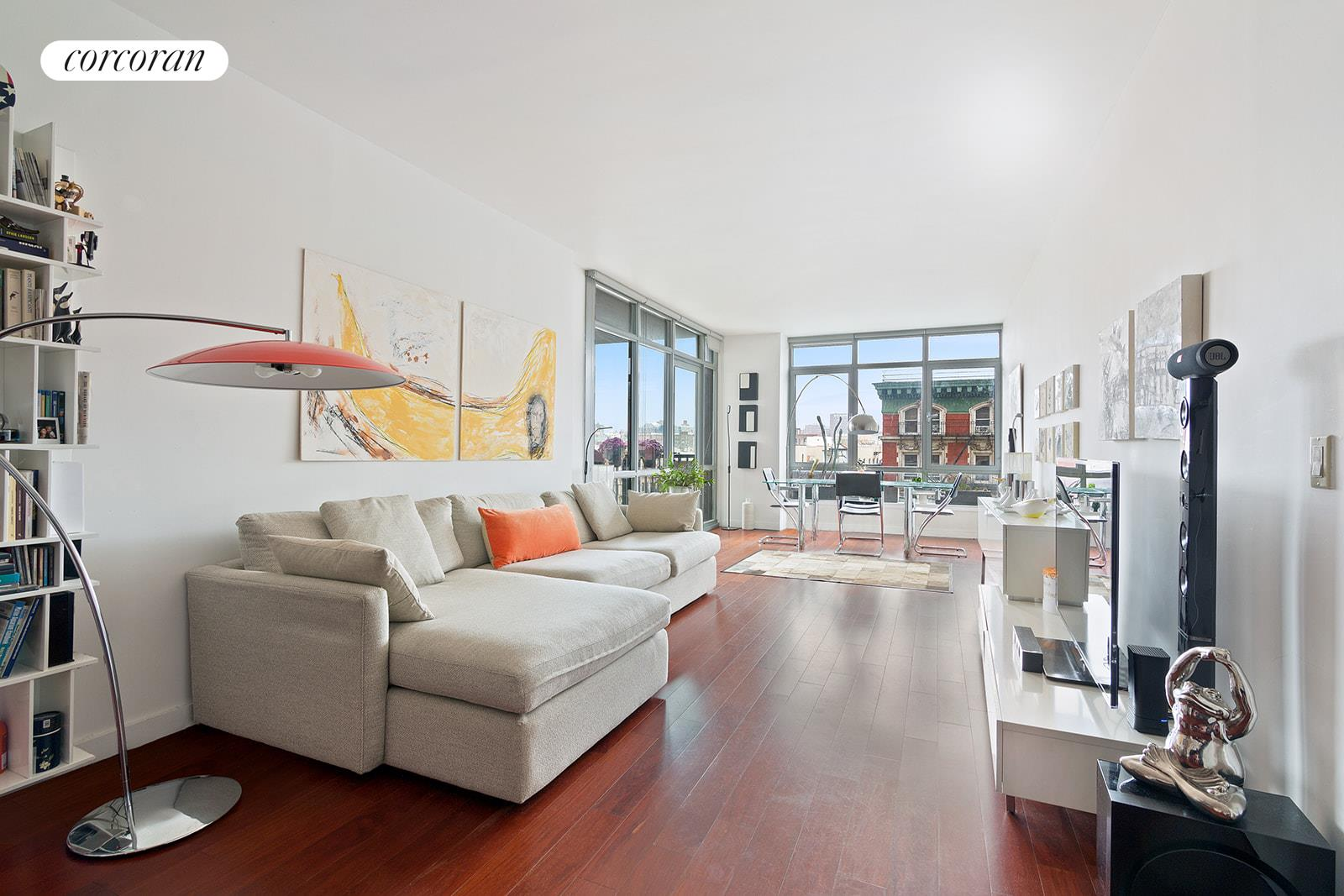 """Incredible walls of glass welcome you to this oversized two bedroom, two bathroom residence in one of Harlem's most desirable, white glove condominiums. Apartment 7F offers beautiful South and East views from the massive living space and private terrace. Enjoy fabulous natural light from the open kitchen with stainless steel appliances and breakfast bar.The spacious master bedroom with unobstructed views from the two large windows feature three closets, one being a walk-in and an en suite bath with separate shower and soaking tub. The secondary bedroom is sizable and enjoys beautiful light and views.Pristine cherry wide-plank wood floors, central air conditioning, in unit washer and dryer, a dreamy amount of closets and gallery-quality wall space to showcase art complete this perfectly proportioned home.""""5th on the Park"""" is a white glove building which offers a pool, gym, two common terraces and a playroom. There is a garage in the building as well. This unique high-rise building in South Harlem is located right on Marcus Garvey Park and Central Park is only a few blocks away. The green line's and red line's stations are close by which allows quick access to Midtown and Downtown Manhattan and beyond, and there are a myriad of great restaurants, shops and services close by. Pets allowed. Tax abatement until 2034."""