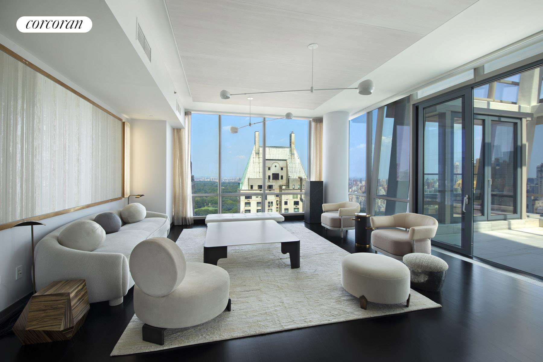 Featuring one of the most unique and tasteful floor plans of any residence on Billionaire's Row, One57, Apartment 41D is an impressive 5 bedroom, 5.5 bathroom duplex condo with full length exposures to the North, East and South. One of only two residences in One57 to boast private outdoor space, with staggeringly beautiful views of Central Park and a bright and airy Solarium, this chic and triple mint home with its sweep of elegantly proportioned rooms is a rare and coveted purchasing opportunity that is not to be missed. The entry gallery with a generous coat closet, magnificent staircase leading up to the bedroom wing and floor to ceiling windows facing the Park affords the apartment an ambience that is at once stately and inviting from the moment you enter. Continue past the staircase to discover the Great Room that is just over 43 feet in length and offers 180 degrees of floor to ceiling windows. Adjacent to the Great Room is the home's most extraordinary feature, a prismatic glass Solarium with French doors that lead out to a small terrace overlooking the Park. An eat-in kitchen with an abundance of storage space made possible by a wealth of custom cabinetry from Smallbone of Devizes is located off the foyer for maximal convenience. With top-of-the-line appliances from Miele and Sub Zero and a sprawling island with integrated stools, this kitchen can accommodate the needs of the most discerning chef.Off the entry gallery, a separate wing leads to a king-sized bedroom with en-suite bathroom and an abundance of closet space. A secluded laundry room and an additional powder room to accommodate guests are also located on the first level. Four bedrooms including the Primary await you on the grandiose second level. The Primary suite offers a massive bedroom overlooking the Park, a walk-in closet with floor to ceiling windows, a luxurious stall shower, soaking tub, double vanity and two private WC stalls. All three of the additional bedrooms are king-sized and feature
