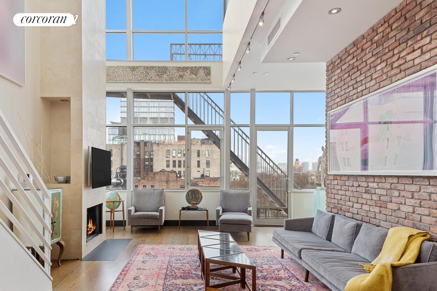 OUTDOOR LIVING!  Your own POOL!   All glass triplex with spectacular open city views.  15 Rivington Street is an intimate boutique condominium nestled at the juncture of the Lower East Side/ Soho/Nolita.   3BR/3BTH 2100 sq ft loft like space with a spectacular  1200 sq ft private roof deck complete with year round  lap pool and fully equipped outdoor kitchen.  Key locked elevator enters directly into this super stylish home with a wood burning fireplace, central air, laundry in unit, and newly renovated open kitchen with premium appliances including  Bosch, Viking, Zuma, Grohe.  Architecturally crafted, dramatic and serene.  A perfect retreat.   Incredibly low monthlies: $897 common charges $1,428 taxes.  A huge storage closet comes with the unit.  Pet friendly, investor and pied a terre friendly.  Located in the most vibrant neighborhood in Manhattan.   The Penthouse at 15 Rivington Street is a one-of-a-kind opportunity.     In-person showings by appointment.