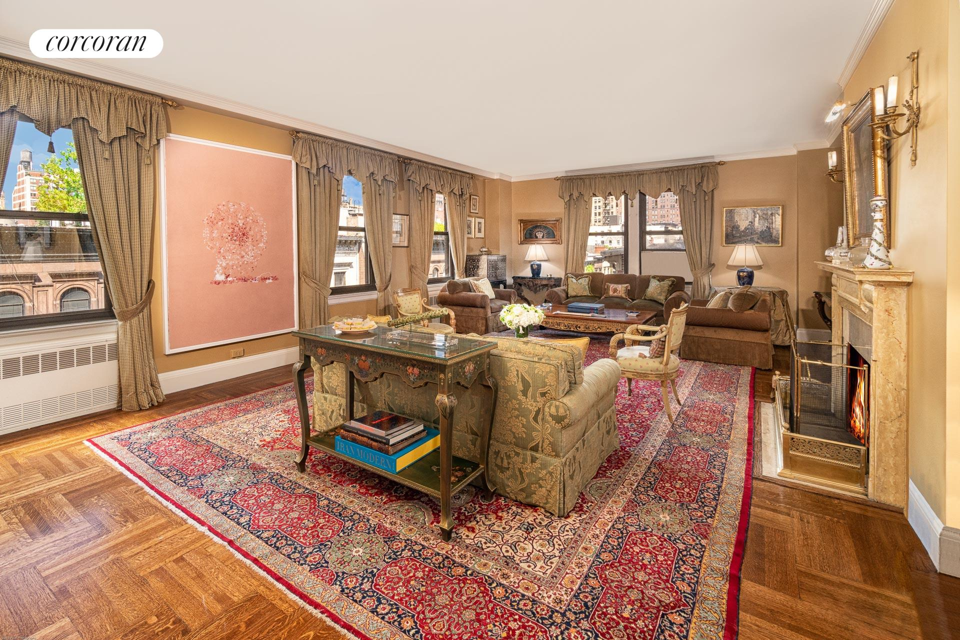 This prewar Fifth Avenue J.E.R. Carpenter twelve room residence is located in one of Carnegie Hill's premier white-glove co-operatives. Drenched in sunlight, the corner residence boasts grand oversized rooms perfectly suited for gracious entertaining and living. There are five bedrooms or four and a library and five windowed full bathrooms. Throughout the magnificent home there are high ceilings, oversized windows, prewar architectural details, hardwood floors, and picturesque views.   A private elevator landing opens onto a gracious entrance gallery that leads to the palatial 28-foot long corner living room which has a wood burning fireplace and five windows facing north and east overlooking the landmarked townhouses on 93rd Street. Adjacent through French doors is the formal dining room which provides an elegant space for gatherings. The dining room can also be accessed off the gallery and connects directly to a butler's pantry with a sink and incredible storage. There is a large windowed eat-in kitchen as well as a second butler's pantry which can be converted into a breakfast room. Off the kitchen is a home office, a laundry room with a side-by-side washer/dryer and a sink, a staff bedroom and a hallway windowed bathroom. Also off the gallery is an enormous corner library or fifth bedroom that faces east over the neighboring gardens and has built-in bookshelves and an office area. The room has an en-suite windowed bathroom and a large walk-in closet. An oversized coat closet completes the public spaces.    As for the private quarters, there is a separate bedroom hallway. In the corner is the extraordinary master bedroom suite which faces south and east overlooking the neighboring townhouse gardens. The suite includes a walk-in closet and an en-suite windowed bathroom. There are three additional bedroom suites all with excellent closet space and two additional windowed bathrooms.    This elegant pre-war cooperative was built in 1926 and houses just forty-one resi