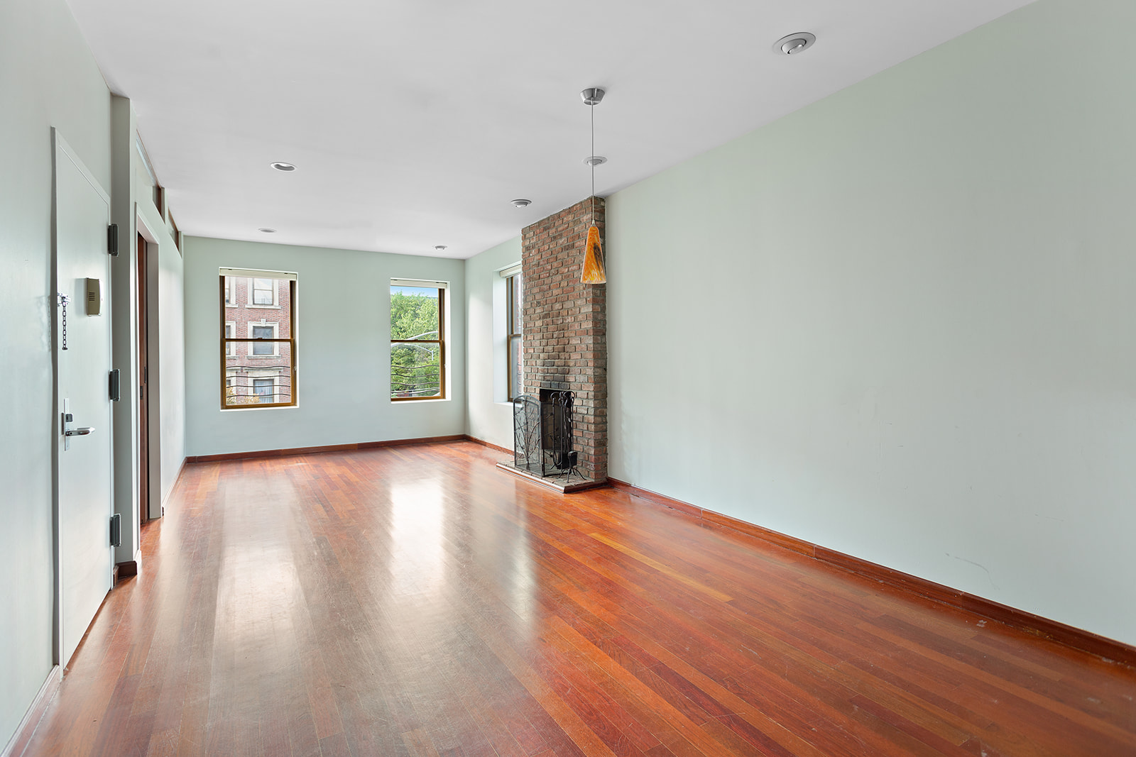 Living large on Fifth Avenue (and 130th Street)!This handsome, oversized one-bedroom apartment combines the open feeling of loft living with the warmth of a traditional residence. Over 1,200 square feet, this generously proportioned unit offers a large master bedroom with a bay window, exposed brick, and a spa bathroom ensuite. A large living area with a wood-burning fireplace is perfect for entertaining with a 6' x 12' adjacent room that could be used as a home office, media room, or nursery. The open, windowed kitchen has stainless steel appliances, excellent cabinets and counter space. A guest bath and full-sized washer and dryer are located off the curving hallway past the kitchen, and central heat and A/C assure your comfort.2119 Fifth Avenue is a corner brownstone built originally in 1890 and now totally renovated. It is convenient to WholeFoods, Red Rooster, a lively restaurant row on Lenox Avenue, and historic, tree-lined Astor Row. Also, it is located for easy access to transportation, including the 2, 3, or 4, 5, 6 subways and the M60 bus to LGA, and Metro North at 125th Street. Pets are welcome!