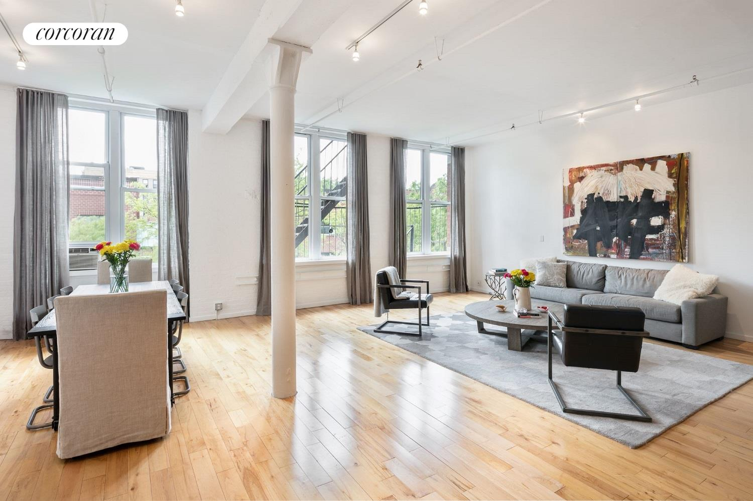 Enjoy true loft living in the East Village with this classic floor-through, two-bedroom, two-bathroom home.Filled with charming old New York details and abundant natural light, thanks to rows of windows facing north and south, this recently renovated 2,000-square-foot loft offers flexible living spaces and plenty of room for lavish entertaining. Enter the truly massive great room and take in soaring ceilings supported by original cast iron columns while three double windows flood the space with southern light. Gleaming hardwood floors will lead you to the updated, open and modern chefs kitchen outfitted with abundant lacquer cabinetry, full-size stainless steel appliances and an extra-large island.Two serene bedrooms are placed at the rear of the home. The roomy master includes an oversized closet, dressing area and en suite bathroom, while the second bedroom is placed near the home's second full bathroom. A separate laundry room with an in-unit washer-dryer and utility sink rounds out this home's coveted details.735 East 9th Street is a handsome brick warehouse co-op conversion that has been home to an exciting array of artists over its hundred-year history. The elevator building is pet-friendly and offers a bike room. Set in historic Alphabet City, you're located less than two blocks from lovely Tompkins Square Park home to a year-round Sunday greenmarket and great community events like the Allen Ginsberg Howl Festival and the Charlie Parker Jazz Festival. A number of bus lines stop within two blocks of the home, including crosstown service via the M8 and M14D, and the L-train station at First Avenue is less than 15 minutes away.