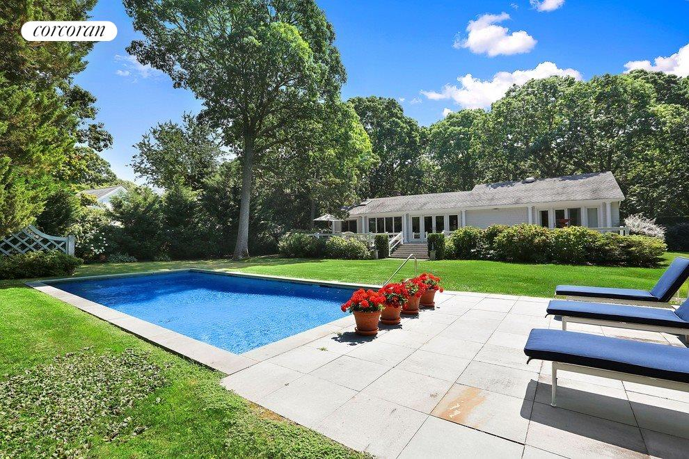 Gorgeous landscaping and complete privacy on .75 acres