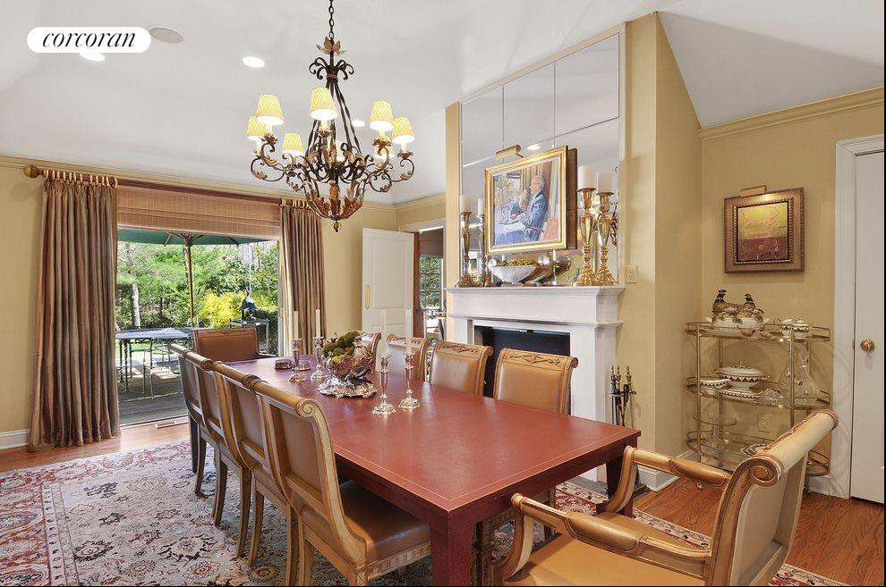 Dining area with fireplace opens to back yard