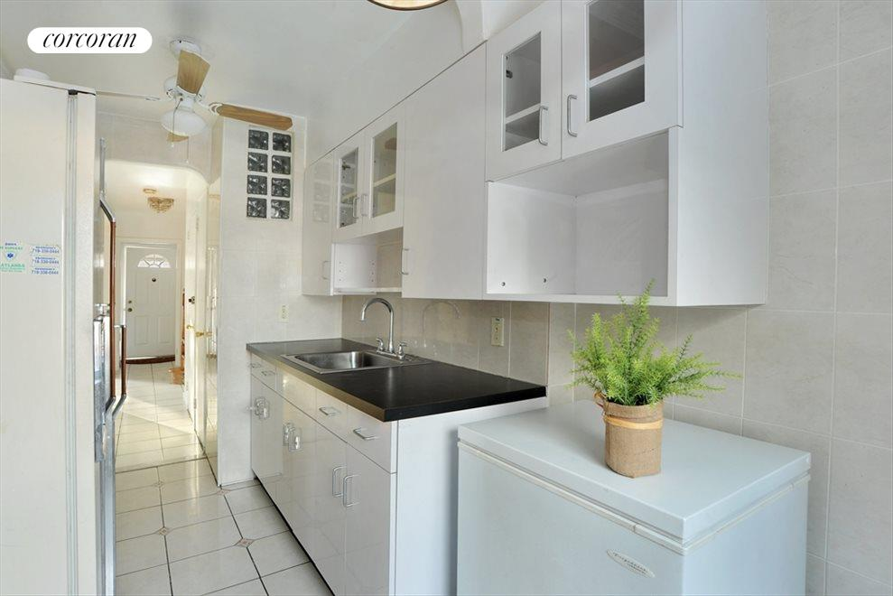 Bright white Eat in Kitchen with window