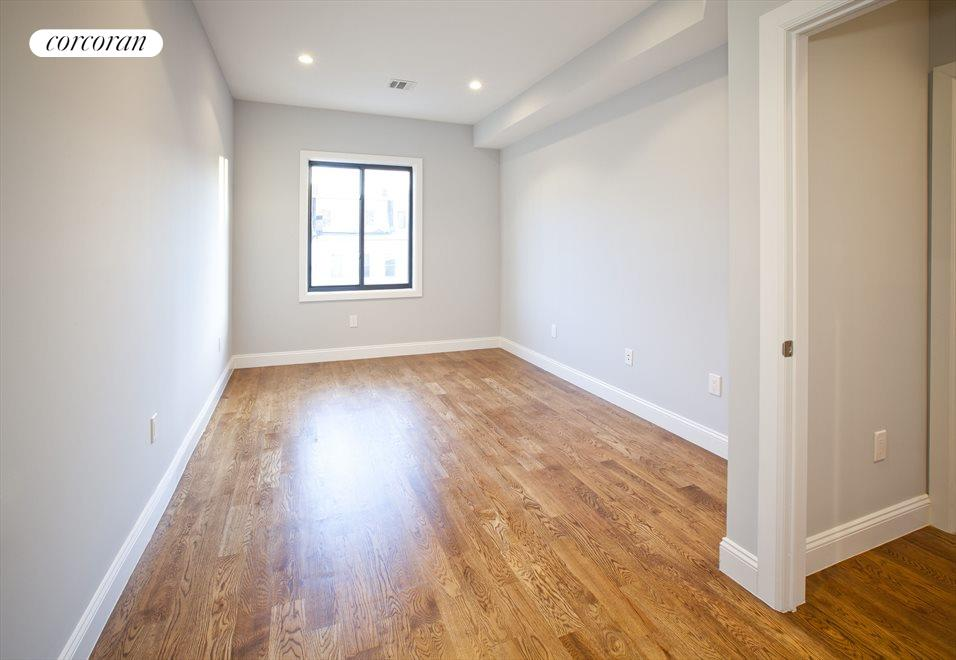 One of two back bedrooms