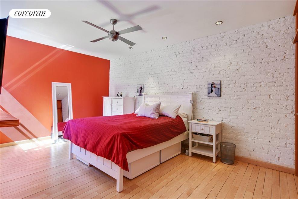 Huge bedroom with custom floor to ceiling closets