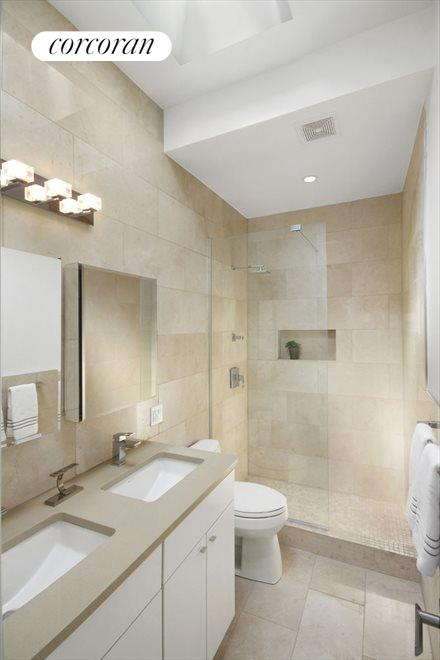 Master Bathroom with glass shower and skylight
