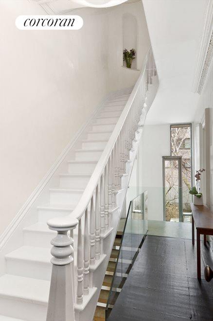 Graceful stair; balcony overlooks garden