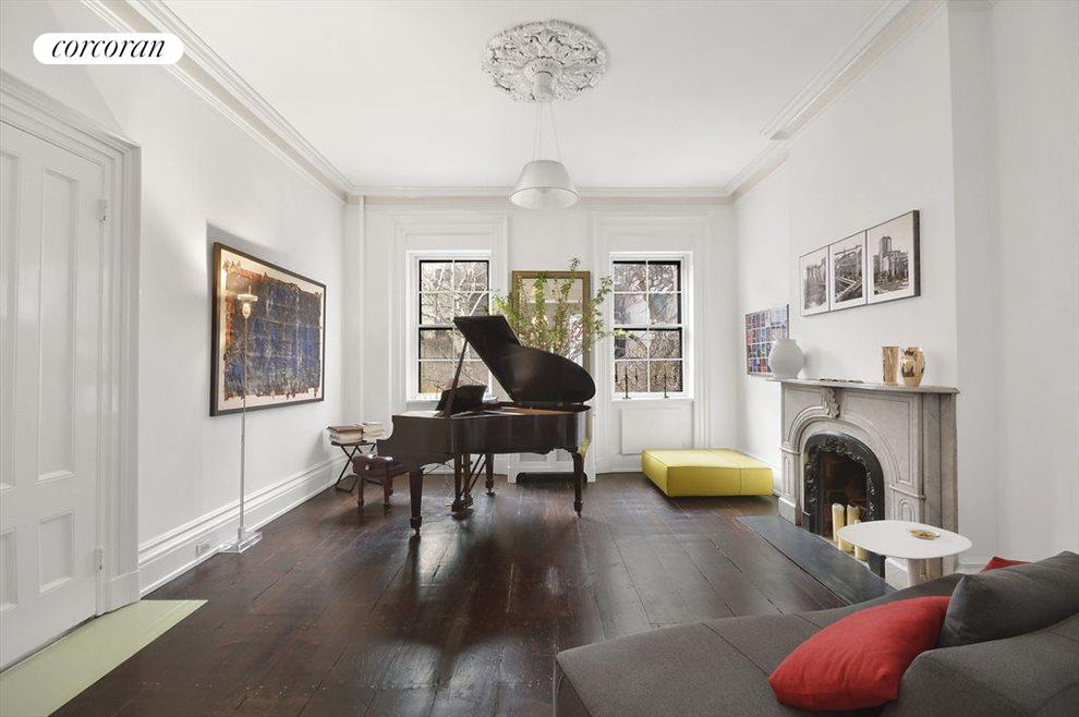 Rear parlor is the perfect music room