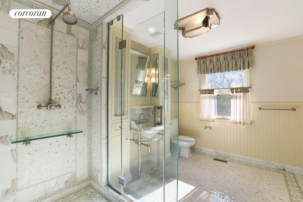 Very pretty master bath with custom tile work