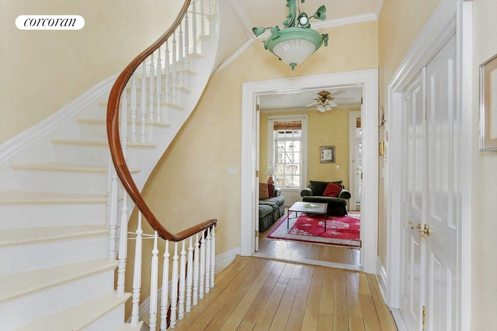Elegant Central Stair with Turned Balustrade