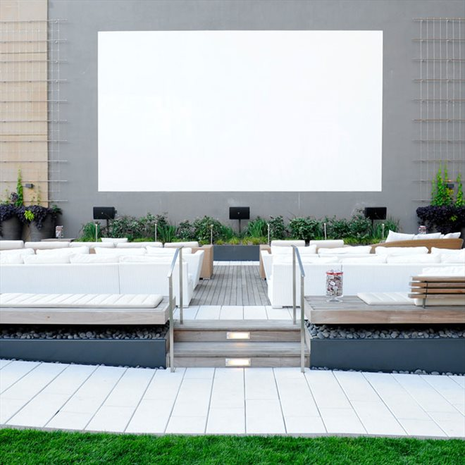 Sun-drenched south law with outdoor cinema.