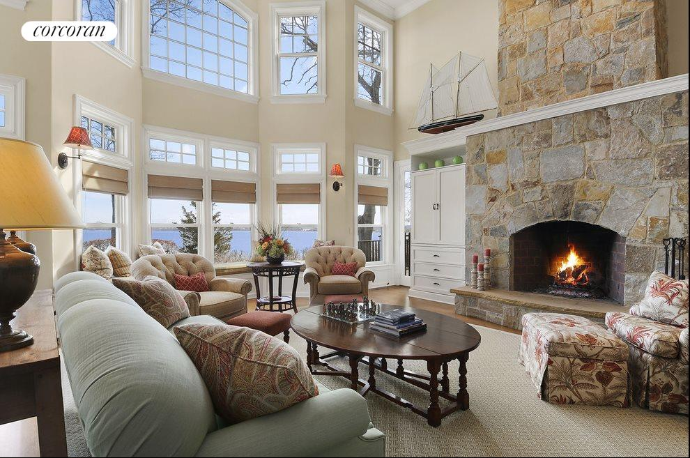 Two story great room with stone fireplace
