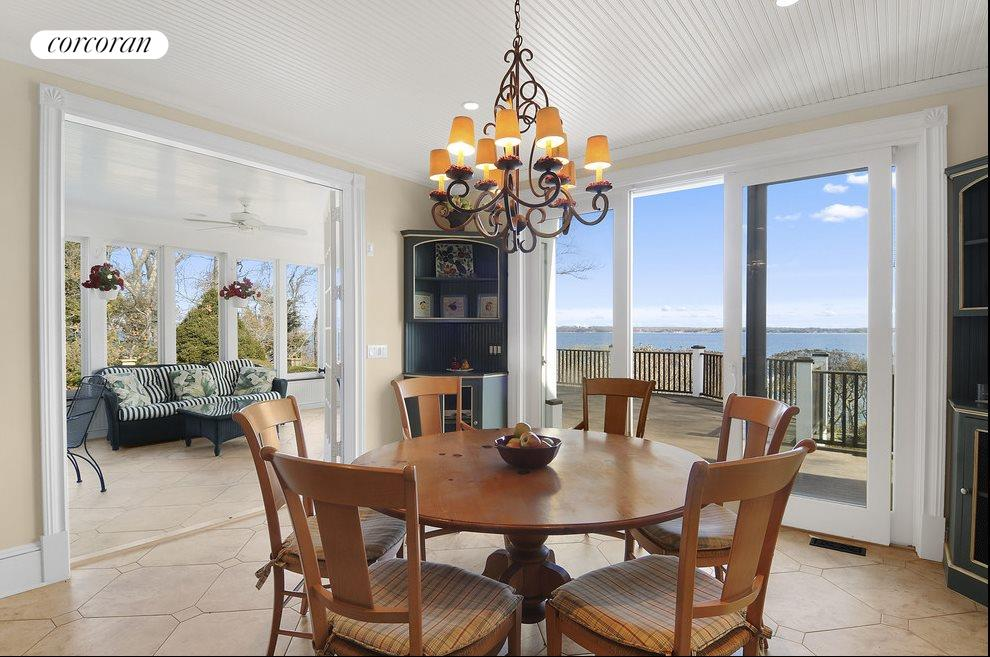 Breakfast room opens to the three-season sunporch