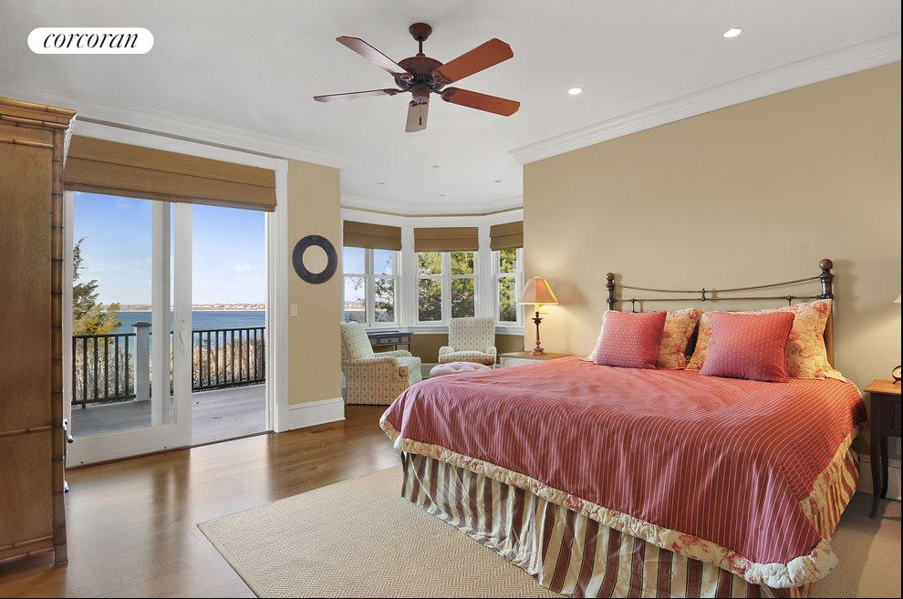 Master suite has fireplace, sitting area, porch, and glorious views