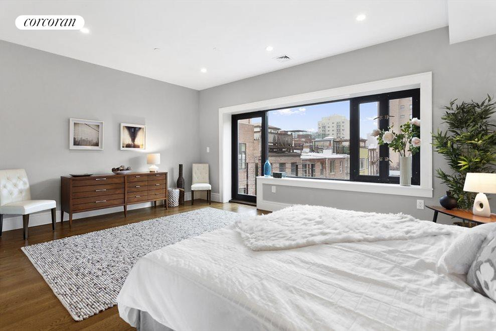 Master bedroom with large picture window & balcony