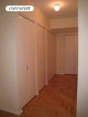 Hallway with 5 closets