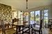 1074 Springs Fireplace Road, Dining room with riverstone fireplace design element