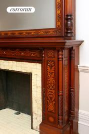 Fireplace mantel detail with mother-of-pearl inlay