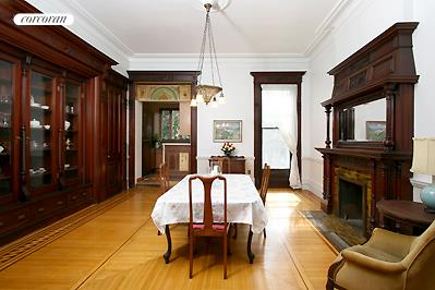 Formal dining room with mahogany glass front cabin