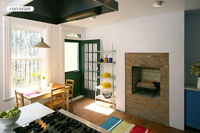 Eat-in kitchen with wood burning fireplace