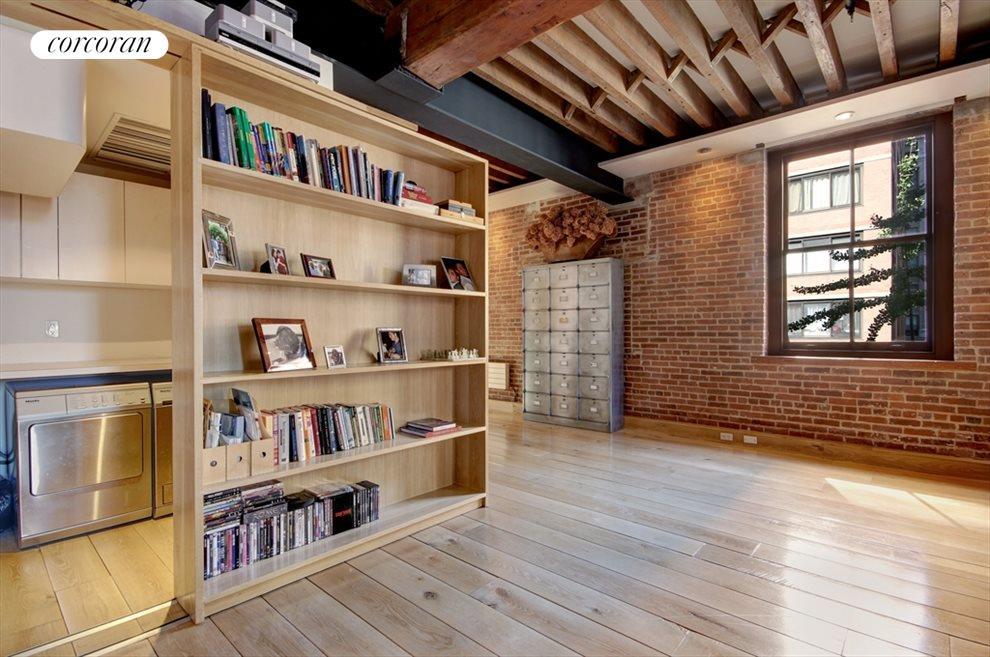Hidden Behind a Sliding Bookshelf,