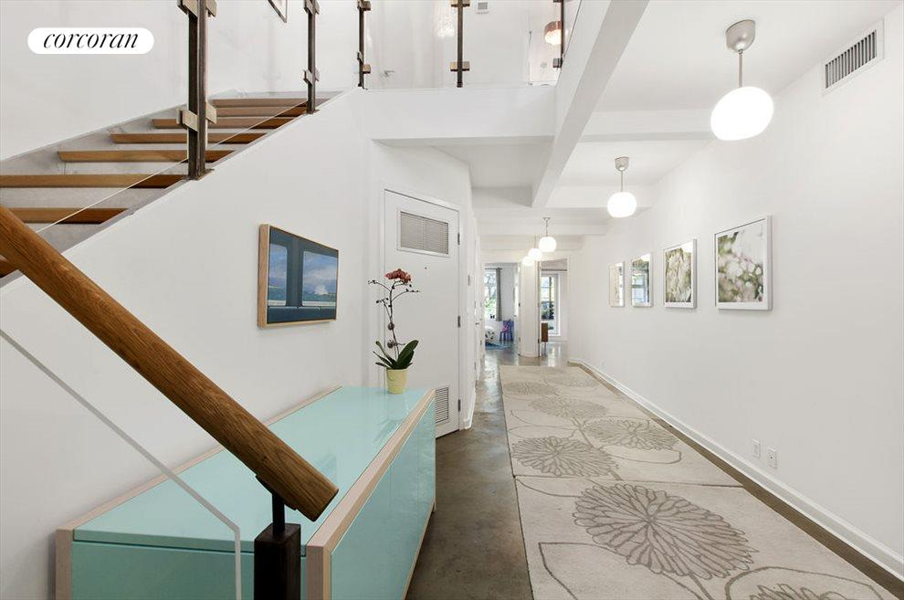 Custom Staircase and Expansive Hall