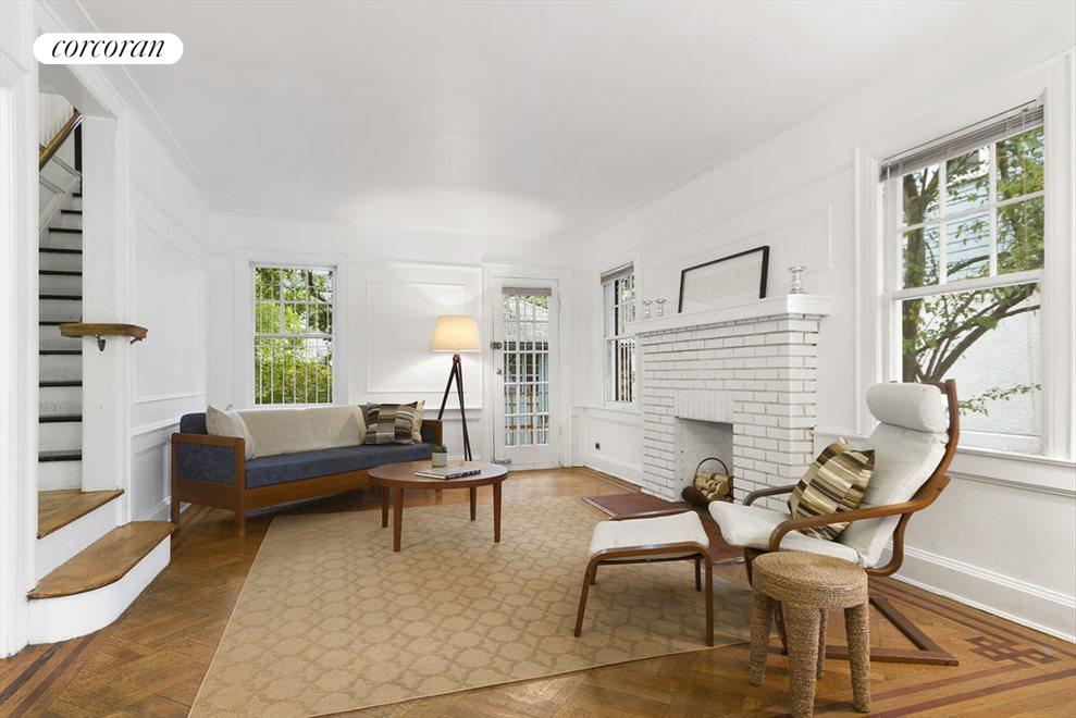 Brick fireplace, original floors and lots of charm