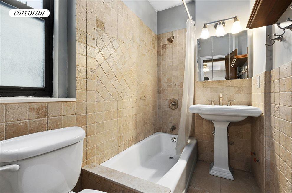 Windowed bathroom, renovated using Italian tile