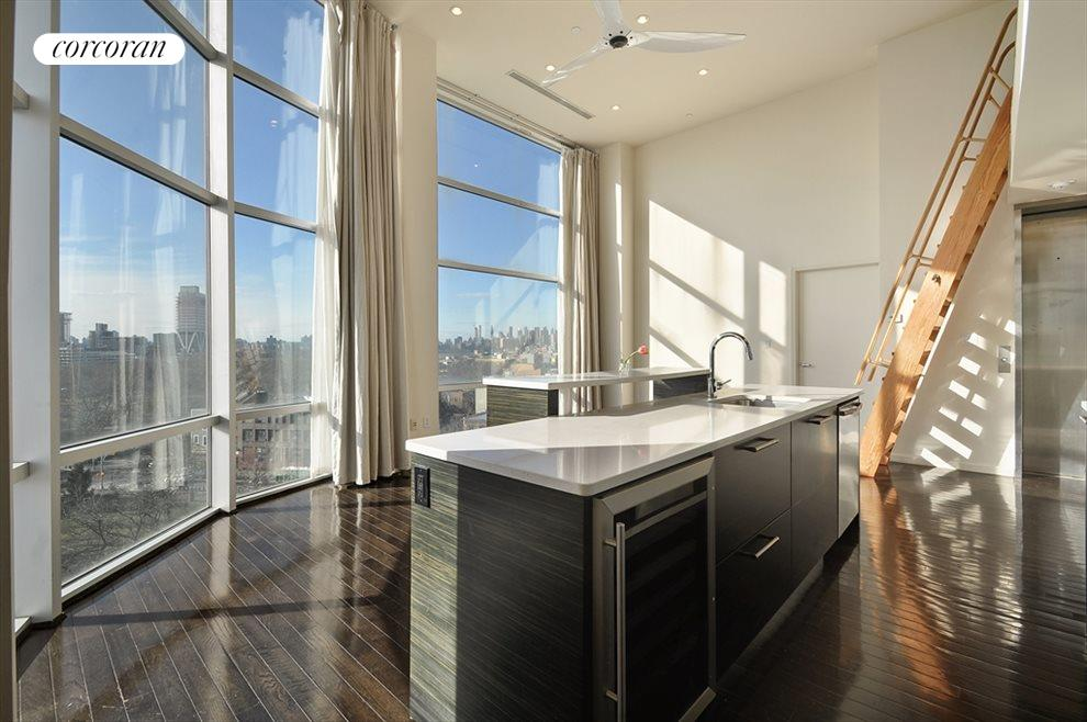 New York City Real Estate | View 524 Manhattan Avenue, #7 | Kitchen / Living Room with ladder to mezzanine